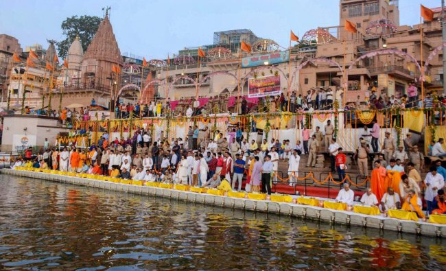 State Agriculture Minister Surya Pratap Shahi with priests and saints offer prayers at Dasammedh ghat on the occasion of Ganga Saptami in Varanasi on Sunday. PTI Photo