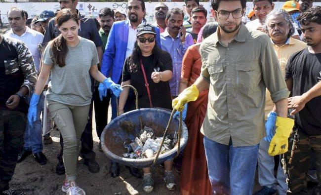 Bollywood actress Dia Mirza and Yuva Sena Chief Aditya Thackery take part in a Beach Clean up and Tree Plantation at Dadar Chowpatty on the occasion of World Earth Day, in Mumbai on Sunday. PTI Photo
