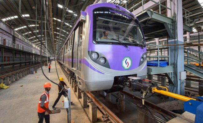 The first rake comprising six coaches of the East-West Metro Corridor stands at KMRCL (Kolkata Metro Rail Corporation Ltd) depot, at Salt Lake near Kolkata on Wednesday. East West Metro corridor runs from Salt Lake Sector to Howrah Maidan. PTI Photo
