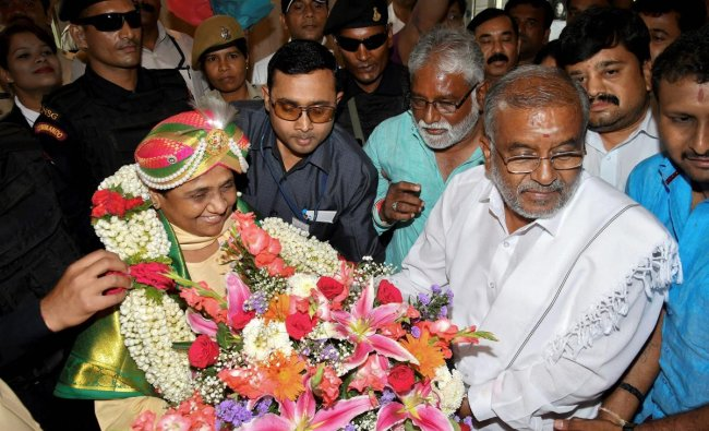 BSP chief Mayawati is accorded grand welcome by her party workers and JD(S) supporters during her visit for campaign for Karnataka Assembly Elections in Mysore on Wednesday. PTI Photo