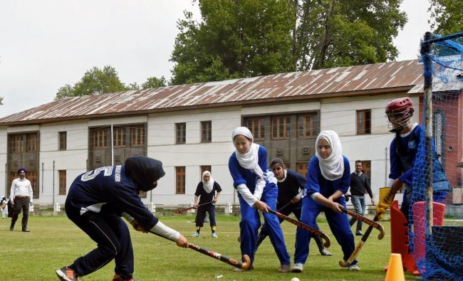 Students in action during an inaugural match of 5-a-side women\'s hockey tournament as it was re-introduced after two decades at Women\'s College in Srinagar on Wednesday. PTI Photo