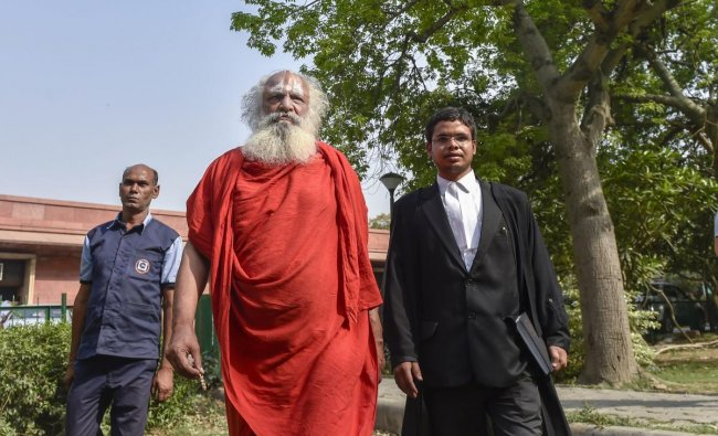 Nirvani Ani Akhara\'s Mahant Dharam Das along with a lawyer comes out of the court after a hearing on Ram Mandir-Babri Masjid case at Supreme Court in New Delhi on Friday. PTI Photo