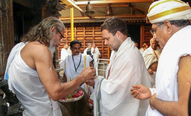 AICC President Rahul Gandhi offers prayers at Manjunatheshwara Temple during his state visit ahead of Karnataka Assembly elections in Dharmasthala on Friday. PTI Photo