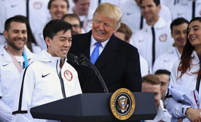 President Donald Trump listens to figure skater Vincent Zhou during a ceremony welcoming the Team USA Olympic athletes on North Portico at the White House in Washington, Friday, April 27, 2018. Zhou became the first figure skater to land a quadruple lutz in any Olympic Games when he completed the jump at the 2018 Winter Olympics. (AP/PTI)