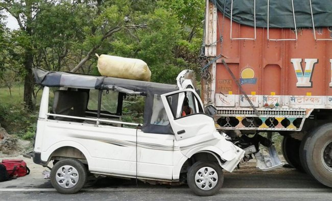 The damaged passenger van that rammed into a truck in Lakhimpur on Saturday. At least twelve people were killed and four other injured in the accident. (PTI Photo)