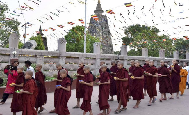 Novice Buddhist monks from Myanmar offer candle prayer on the occasion of Buddha Jayanti at Mahabodhi Temple in Bodh Gaya on Sunday. PTI Photo