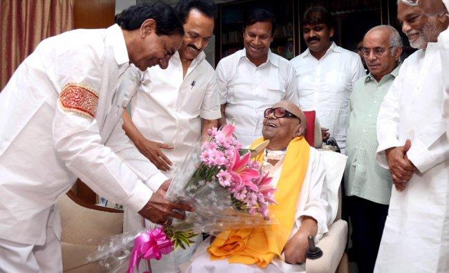 Telangana Chief Minister K Chandrashekhar Rao meets DMK President M Karunanidhi at his residence in Chennai on Sunday. PTI Photo