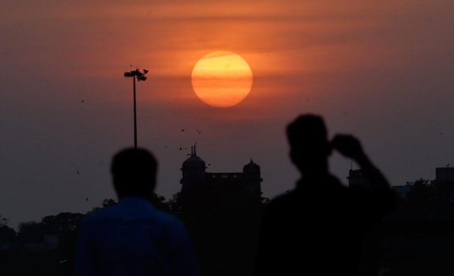A view of the sunset seen from the back water area of Marina beach in Chennai on Sunday. PTI Photo