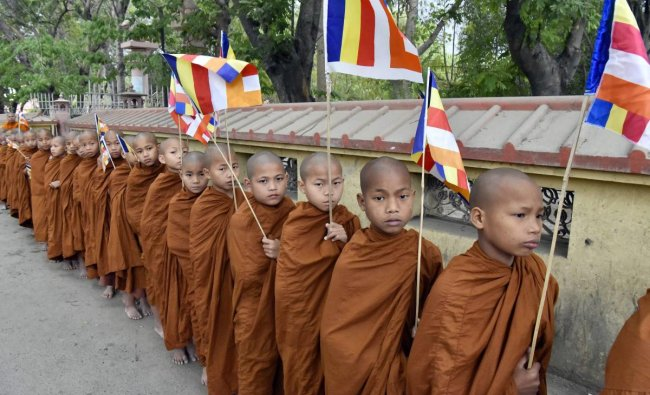 A group of novice monks from Thailand take part in a holy procession on occasion of Buddha Purnima at Bodh Gaya on Monday. PTI Photo
