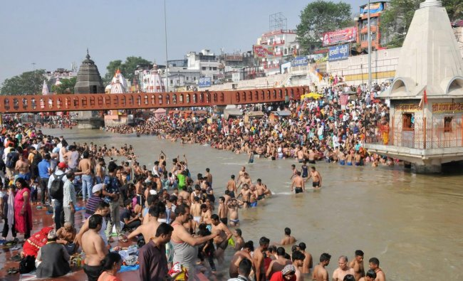 Hindu devotees take a holy dip and offer prayer at Har ki Paudi on the occasion of Buddha Purnima in Haridwar on Monday. PTI Photo