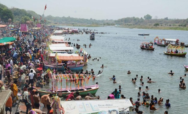 Devotees gather on the banks of the Narmada river to take bath on the occasion of Buddha Purnima, in Jabalpur on Monday. PTI Photo