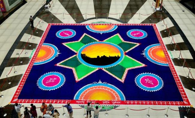 An \'eco-friendly\' Rangoli, measuring 50x50 feet, created by Sanskar Bharthi to celebrate Maharashtra Day at Seawoods in Navi Mumbai on Tuesday. PTI Photo