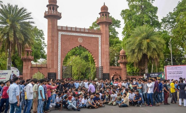 Aligarh Muslim University students protest at the gate of the university campus in Aligarh on Wednesday. PTI Photo