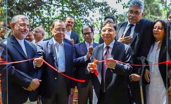 Chief Justice of India Dipak Misra inaugurates a creche facility at Supreme Court in New Delhi on Wednesday. PTI Photo
