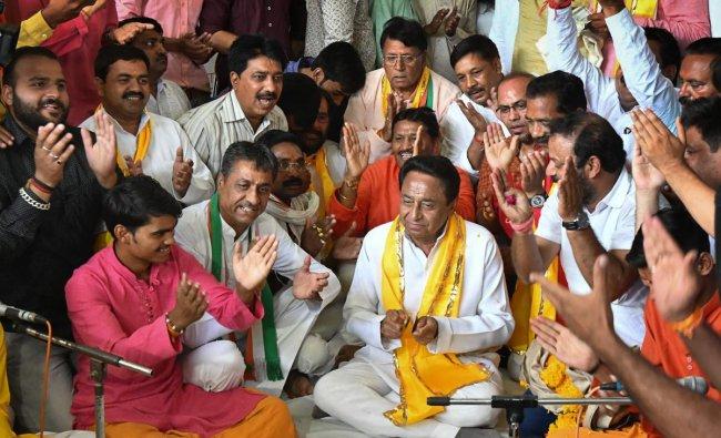 Newly appointed Madhya Pradesh Congress Committee President Kamal Nath takes part in a Hanuman Chaalisa recitation (prayers) at Gufa Mandir in Bhopal on Wednesday. PTI Photo
