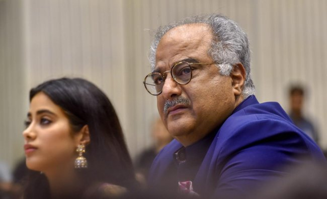 Film producer Boney Kapoor and his daughter Janhvi, during the 65th National Film Awards function at Vigyan Bhavan in New Delhi on Thursday. The family received Best Actress Award on behalf of actress Sridevi who died recently. PTI Photo