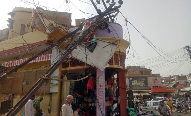 A damaged electric pole is pictured in a market after strong winds and dust storm in Alwar, in the western state of Rajasthan, India May 3, 2018. REUTERS