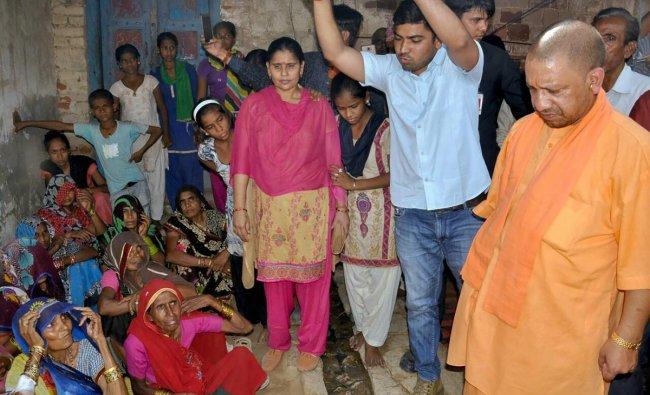 Uttar Pradesh Chief Minister Yogi Adityanath meets the victims of Wednesday\'s storm, in in Mahua Khera on Saturday. PTI