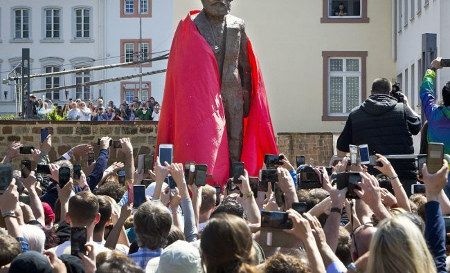 A bronze statue showing German philosopher Karl Marx is unveiled on occasion of the 200th birthday of Marx in Trier, Germany, Saturday, May 5, 2018. The statue was created by Chinese artist Wu Weishan and is a present of China. AP/PTI