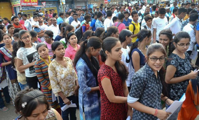 Applicants wait outside an examination centre to appear in the National Eligibility-Cum-Entrance Test (NEET) (UG) 2018 conducted by Central Board of Secondary Education (CBSE) in Jabalpur on Sunday. PTI