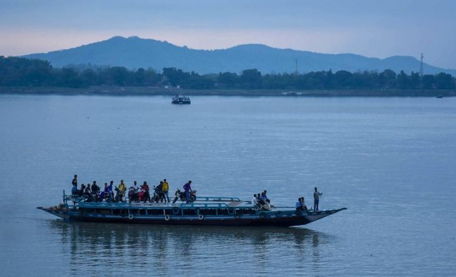 A passenger ferry crosses Brahmaputra river in Guwahati on Monday. With an increase in rainfall on the higher parts North-Eastern states there is a significant rise in the water level of Brahmaputra River. PTI