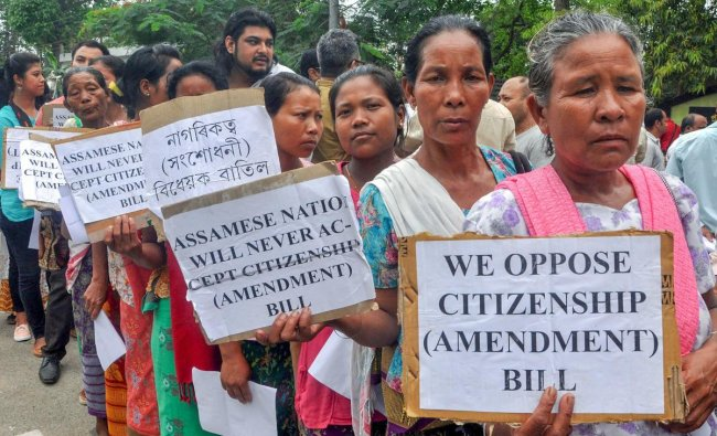 Members of different organizations and individuals hold placards against the Citizenship (Amendment) Bill, 2016 hearing by Joint Committee at the Assam Administrative Staff College, Khanapara in Guwahati on Monday. PTI