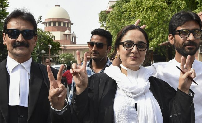 Kathua rape victim\'s lawyer Deepika Singh Rajawat, shows victory sign after Supreme Court directs fast-track trial and transfer of Kathua gang-rape and murder case to Pathankot in New Delhi on Monday. PTI