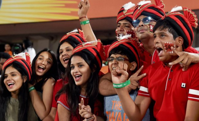 Sunrisers Hyderabad supporters cheer for their team during Indian Premier League match against Royal Challengers Bangalore in Hyderabad on Monday. PTI