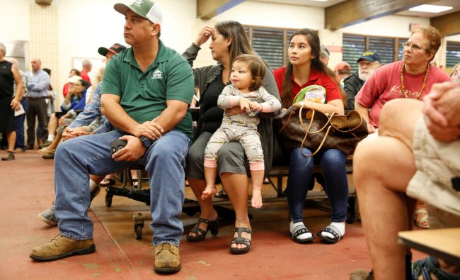 Puna District resident Ray Kaaihue and his family attend a community meeting on the ongoing eruptions of the Kilauea Volcano at Pahoa High and Intermediate School in Pahoa. Reuters photo