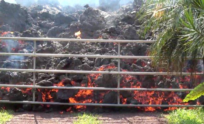 Lava advances towards a metal barrier in Puna, Hawaii, U.S. Reuters photo