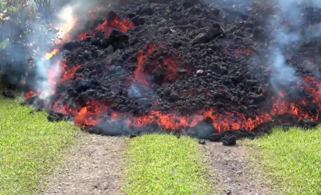 Advancing lava covers the grass in Puna, Hawaii, U.S. Reuters photo