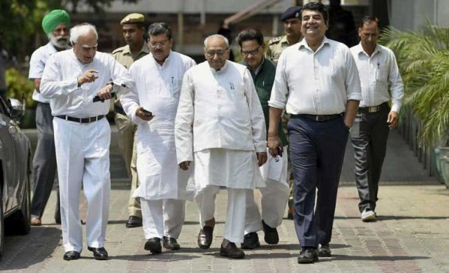 Senior Congress leaders Kapil Sibal, Motilal Vora, R P N Singh and other leaders leave after meeting with Election Commissioner of India at Nirvachan Sadan in New Delhi, on Friday. PTI