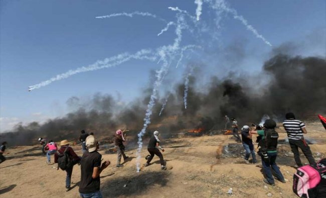 Tear gas canisters are fired by Israeli forces at Palestinian demonstrators during a protest demanding the right to return to their homeland, at the Israel-Gaza border in the southern Gaza Strip, May 11, 2018. REUTERS