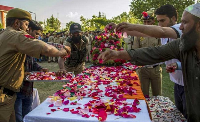 Police personnel pay floral tribute to SG constable Shamim Ahmad, who was killed in a militant attack at Wadwan, in Budgam on Friday. PTI photo.