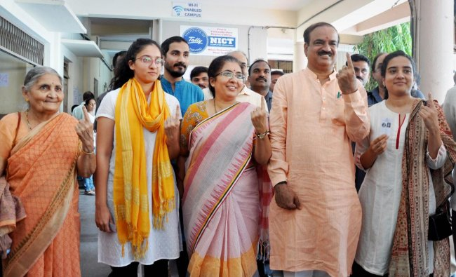 Union Minister Ananth Kumar with his family show their inked finger after casting their ballot during the polling day for the Karnataka Assembly election 2018 in Bengaluru on Saturday. PTI Photo