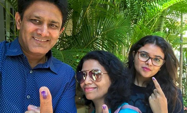 Former cricket captain Anil Kumble, along with his family, shows his finger marked with indelible ink after casting votes for Assembly elections in Bengaluru on Saturday. (PTI Photo / Twitter@anilkumble1074)