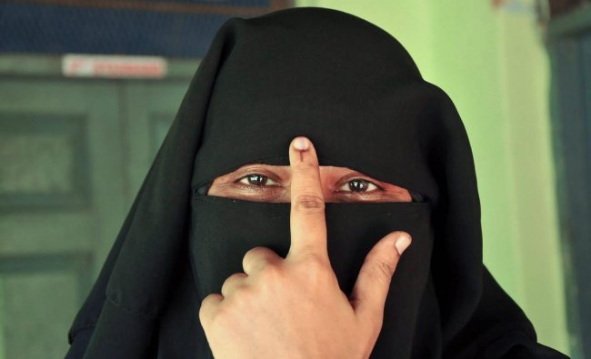 A voter shows ink stained finger after casting her ballot during the polling day for the Karnataka Assembly election 2018 in Chikmagalur on Saturday. PTI Photo