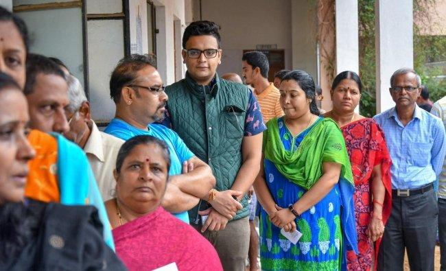 The scion of the erstwhile Mysuru royal family, Yaduveer Krishnadatta Chamaraja Wadiyar, waits in a queue to cast his ballot during Karnataka Assembly elections in Mysore on Saturday. PTI Photo