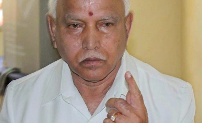 BJP\'s chief ministerial candidate B S Yeddyurappa shows his inked finger after casting for Assembly elections at Shikaripur in Shivamoga district on Saturday. PTI Photo