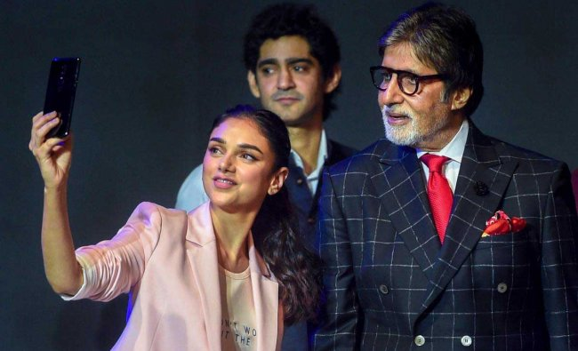 Bollywood actors Amitabh Bachchan and Aditi Rao Hydari take selfie during a phone launch in Mumbai on Thursday. PTI Photo