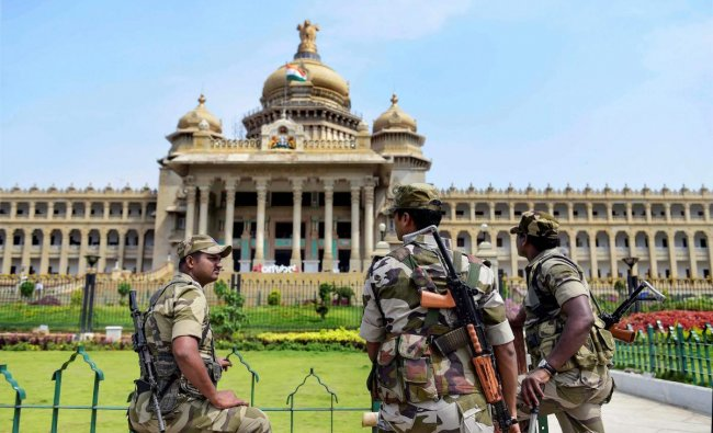 CISF personal stand guard during the oath taking ceremony of the newly elected members of the house at Vidhana Soudha in Bengaluru. PTI Photo