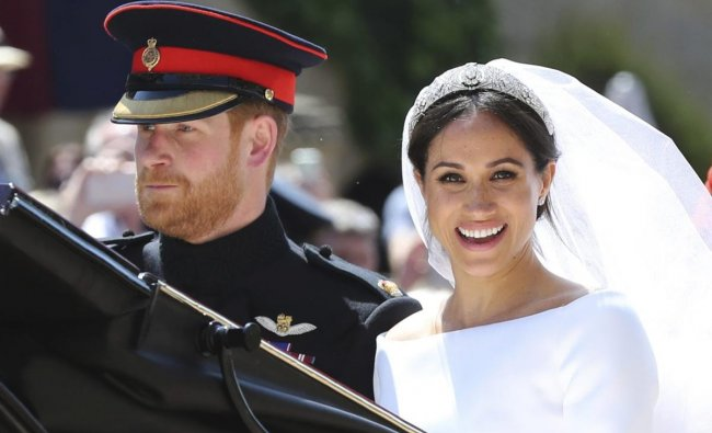 Britain\'s Prince Harry and his wife Meghan Markle leave after their wedding ceremony, at St. George\'s Chapel in Windsor Castle in Windsor, near London, England, Saturday. AP/PTI Photo