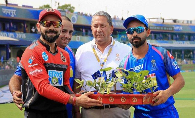Royal Challenger Bangalore skipper Virat Kohli and Rajasthan Royals skipper Ajinkya Rahane exchange plants ahead their IPL T-20 cricket match at Sawai Mansingh Stadium, in Jaipur, on Saturday. PTI Photo