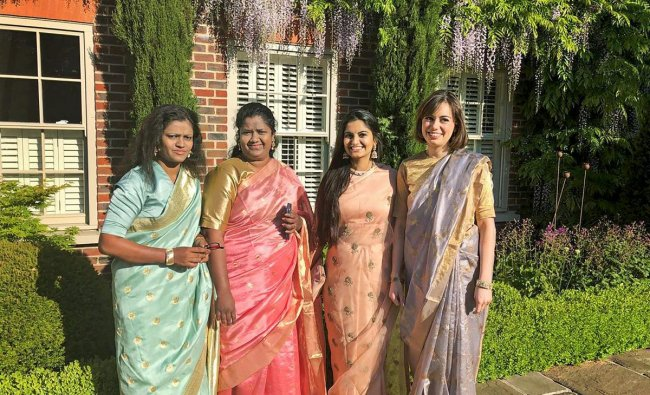 Suhani Jalota, founder of Myna Mahila Foundation along with her colleagues Deborah Das, Archana Ambre and Imogen Mansfield arrive for the royal wedding in Windsor Castle on Saturday. PTI Photo