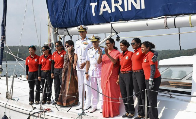 Union Defence Minister Nirmala Seetharaman and Indian Navy chief Admiral Sunil Lanba greet the Indian Navy\'s six-member all-women crew of INSV Tarini, who circumnavigated the globe in over eight months, at Panaji in Goa. PTI Photo