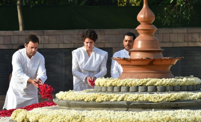 Rahul Gandhi with his sister Priyanka Gandhi-Vadra pay tribute to their father, former Prime Minister Rajiv Gandhi on his 27th death anniversary at his memorial \'Vir Bhumi\' in New Delhi. PTI Photo