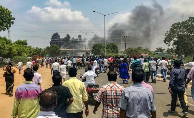 Smoke billows out of burning vehicles after a violent protest demanding closure of Vedanta\'s Sterlite Copper unit entered the 100th day, in Tuticorin. The police opened fire in which at least nine people have been killed. PTI Photo