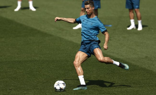 Real Madrid\'s Cristiano Ronaldo trains during a open media day at the team\'s Veldebebas training ground in Madrid. AP/PTI Photo