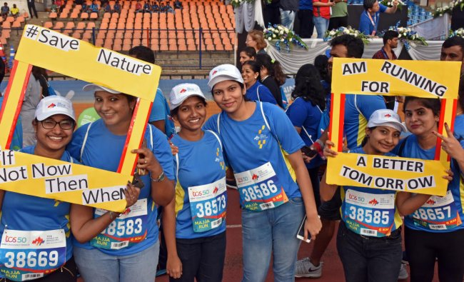 People participate in TCS world 10K run organised by Procam International Private Limited at Kanteerava Stadium in Bengaluru on Sunday. DH Photo