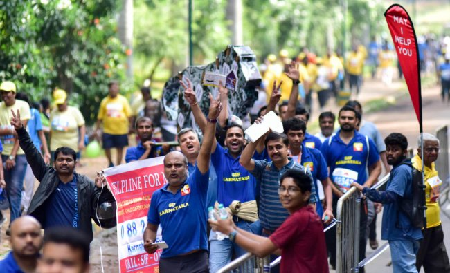 People participate with social slogans in TCS world 10 K run, at Sree Kanteerava Stadium, in Bengaluru on Sunday.DH Photo